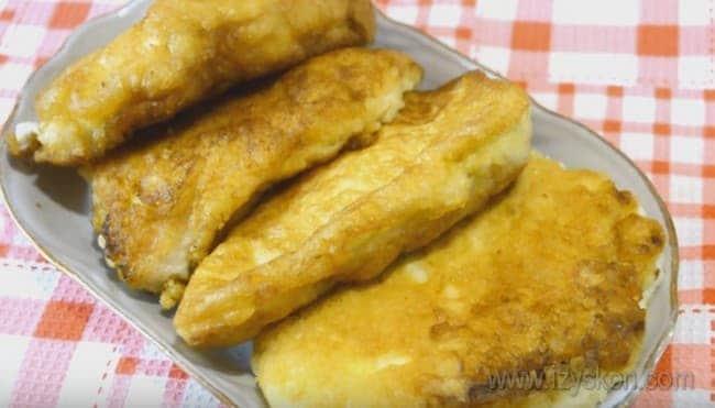 куриные отбивные в кляре в духовке получаются золотистыми и очень аппетитно выглядят.